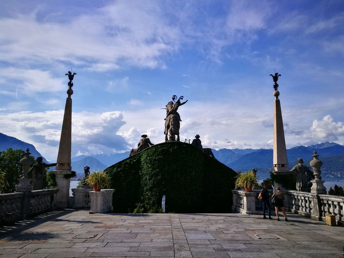 The top of the garden at Isola Bella Borromean Islands Isola Bella, Lago Maggiore , Italy Lago Maggiore, Italy Historical Monuments Historic Historic Garden Napoleon Formal Garden Garden Photography Famous Gardens Sky And Clouds Unıcorn Viewpoint Postcards From Italy Visititaly Travelingtheworld  Tourism Italy City Statue Sculpture Tree Memorial History Sky Architecture