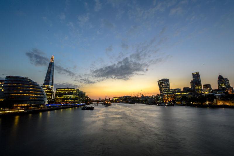 Modern city lit up at dusk