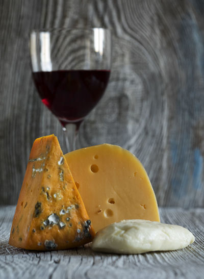 Fresh pieces of cheese (Mozzarella, roquefort, Maasdam) and wine on old wooden weathering background Background Bread Cheese Close-up Food Food And Drink French Food Fresh Freshness Healthy Eating Indoors  Maasdam Mozzarella No People Old Pieces Red Wine Roquefort Table Toasted Bread Weathering Wine Wooden