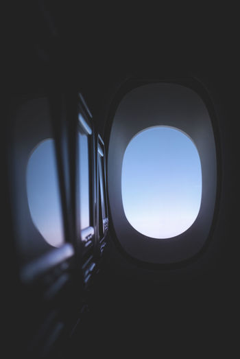 less saturation Sky Window Airplane Air Vehicle No People Geometric Shape Shape Transportation Day Indoors  Architecture Nature Travel Low Angle View Clear Sky Circle Transparent Vehicle Interior Built Structure Dark Directly Below