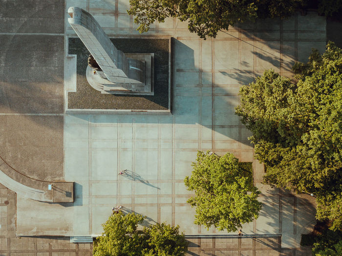Evening shadows DJI X Eyeem Drone  Aerial Architecture Building Building Exterior Built Structure City Day Evening Shadows Glass - Material House Lithuania Travel Mavic Mavic Pro Nature No People Outdoors Plant Pool Reflection Sunlight Swimming Pool Transparent Tree Window