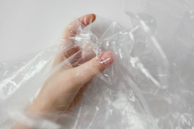 Close-up of woman hand holding plastic bag