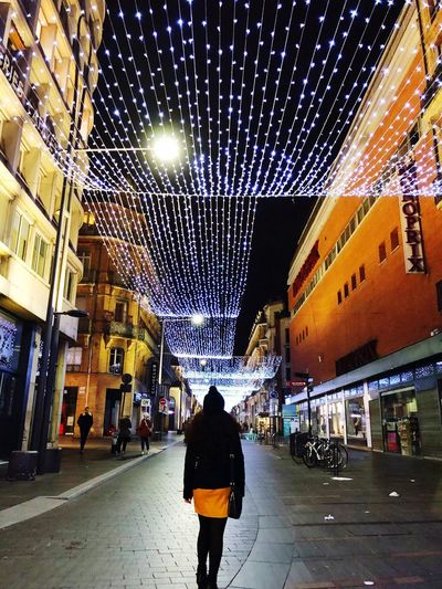 Toulouse EyeEmNewHere EyeEm Best Shots Eyes4photography Christmas Decoration Light Christmas Ilumination Toulouse Rear View Real People Architecture Illuminated Building Exterior City Night Street One Person Women City Life Light Lighting Equipment Walking Lifestyles 2018 In One Photograph