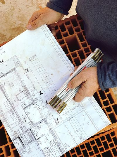 Job Job Of The Day Human Hand Skill  High Angle View Working Adults Only Indoors  Expertise Occupation Adult Only Men Day Architectural Detail Professional Building Story Building Plans