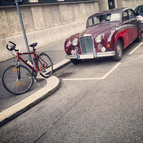 A retro car parked next to a bicycle Austria Street Life Vienna Bicycle Bicycling Bike Car City Contrast Garage Land Vehicle Luxury Car Mode Of Transportation Motor Vehicle No People Parking Retro Styled Road Sport Stationary Street Transportation Wheel Wien
