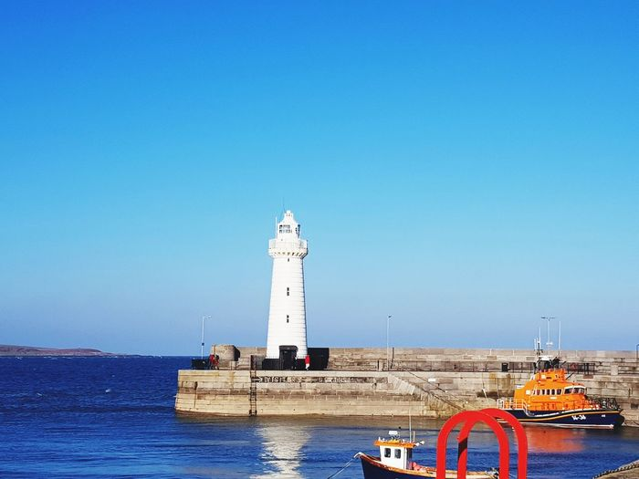Lighthouse Ireland Lighthouse Direction Sea Guidance Beach Tower Nautical Vessel Blue Sky Water Architecture Outdoors Horizon Over Water Water's Edge No People