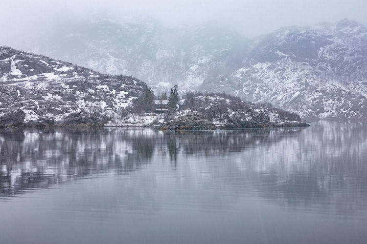 Norway Northern Norway Nordland Lofoten Lofoten Islands Snowing Weather Grey Winter Cold Temperature Water Snow Beauty In Nature Nature Tranquility No People Day Tranquil Scene Reflection Scenics - Nature Waterfront Lake Outdoors Fog Tree Mountain Environment Snowcapped Mountain