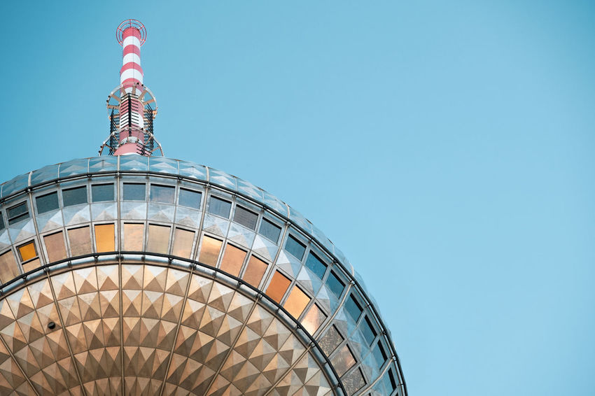 Fernsehturm TV Tower Architecture Blue Building Building Exterior Built Structure City Clear Sky Close-up Copy Space Day Low Angle View Modern Nature No People Office Building Exterior Sky Skyscraper Spire  Sunset Tall - High Tourism Tower Travel Destinations