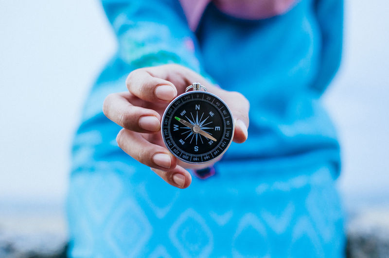 Compass in hand Adult Close-up Day Direction Guidance Holding Human Body Part Human Hand Navigational Compass One Person Outdoors People Real People Time