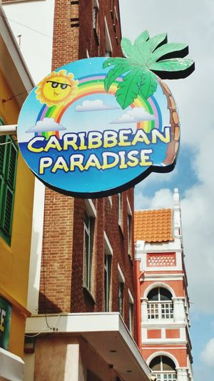 Carribbean City Multi Colored Text Architecture Sky Building Exterior Built Structure Commercial Sign