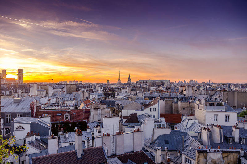 A parisian sunset/skyline on a rooftop Architecture Blue Hour Cityscape City Cityscape High Angle View Night No People Outdoors Paris Paris Rooftops Roof Rooftop Rooftops Sky Skyline Sunset Urban Skyline The Traveler - 2018 EyeEm Awards