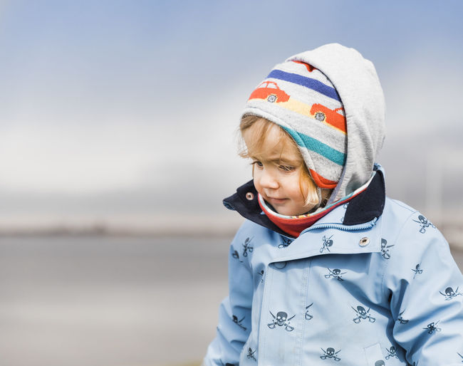 Cute Girl Looking Away During Winter