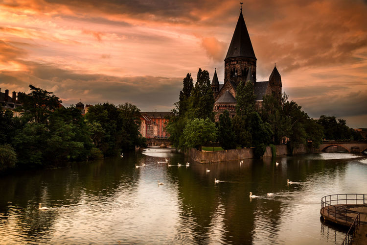 Architecture Building Exterior Built Structure Church Cloud Cloud - Sky Cloudy Nature No People Orange Color Outdoors Place Of Worship Religion River Sky Spirituality Sunset Tourism Travel Destinations Tree Water Waterfront Showcase June Colour Of Life