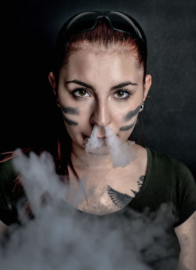 military woman Military Smoke Smoking The Portraitist - 2019 EyeEm Awards Beautiful Woman Beauty Portrait Black Background Young Women Headshot Women Close-up Witch Eye Make-up Eyelash Eyebrow Vampire