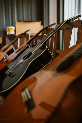 In A Row Guitar Guitars Guitar Love Music Musical Instrument Musical Equipment Musician School Classes String Instrument Arts Culture And Entertainment Wood - Material Indoors  String Musical Instrument String No People Bow - Musical Equipment Close-up Acoustic Guitar Still Life Learning Analogue Sound