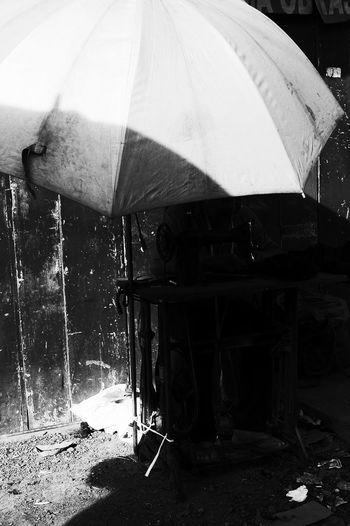Man with umbrella in rain during rainy season