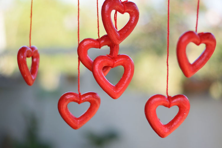 Close-up of red heart shape decorations hanging outdoors