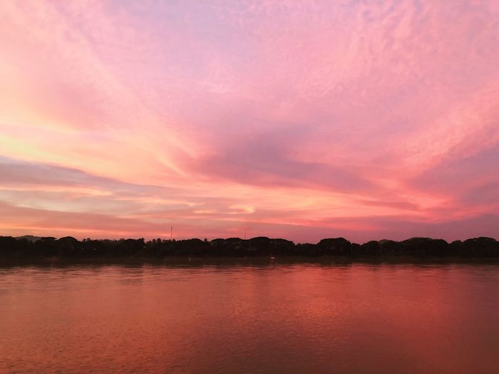 Vanilla sky Scenics Riverside Nature Beauty Khong River Sky Collection Shade Of Sky Shade Of Light Sky Pink Vanilla Sky Beauty In Nature Sunset Water Nature Lake Tranquil Scene Scenics Tranquility No People Sky Waterfront Tree Outdoors Reflection Silhouette Day