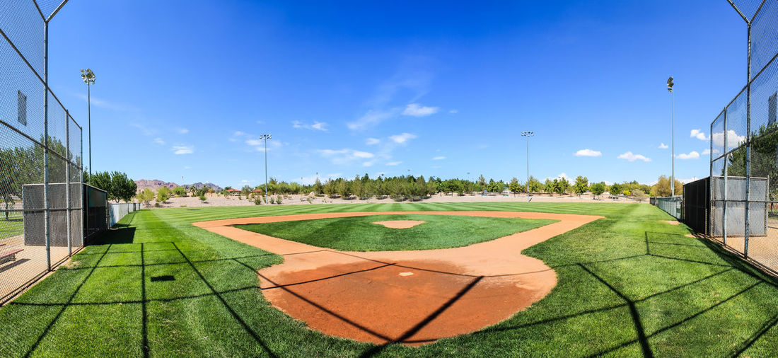 A quiet baseball field Sky Nature Day No People Outdoors Grass Plant Green Color Sport Cloud - Sky Tree Baseball Field Sports Dirt Blue Sky Blue Sky And Clouds Summer Clear Panorama Panoramic Wide Angle