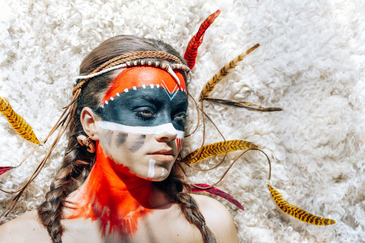 Roots. American Indian Indian American Colours Colors Body Painting Feathers Ethnic Portrait Portrait Of A Woman One Person One Woman Only One Young Woman Only Young Women Stage Make-up Ceremonial Make-up Body Paint Eye Make-up Make-up Eyeshadow Face Paint International Women's Day 2019