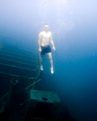 Boy swimming in sea
