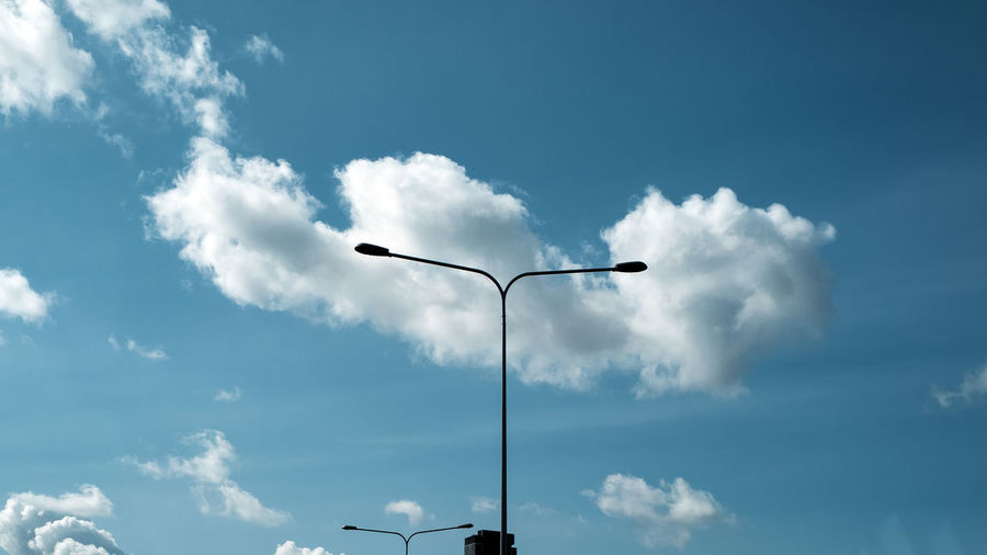 Cloud - Sky Sky Street Light Low Angle View Street Lighting Equipment No People Nature Day Outdoors Blue Technology Beauty In Nature Light Sunlight Electric Light Tall - High Silhouette Pole Electricity