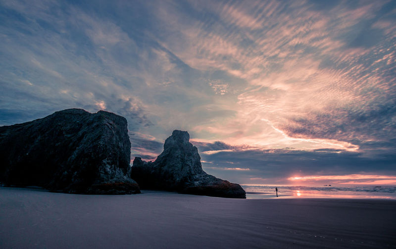 Scenic view of seastacks against sky during sunset