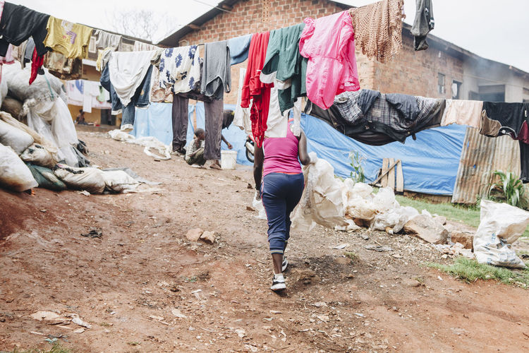Low section of woman walking on field in slum
