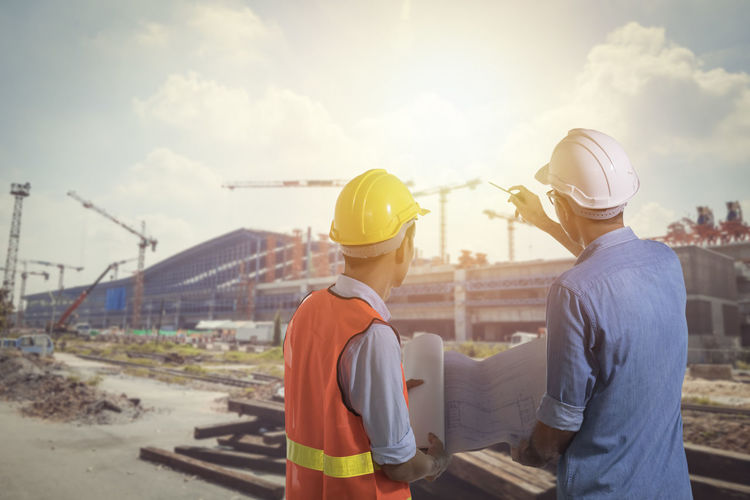 ARCHITECT Architecture Cloud - Sky Construction Industry Construction Site Coworker Design Professional Development Hardhat  Hat Headwear Helmet Industry Men Nature Occupation Outdoors People Real People Rear View Safety Sky Standing Working