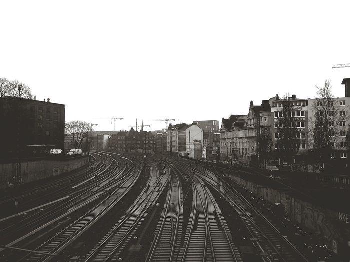 Tristesse. · Hamburg Germany 040 Railroad Tracks Railroad Tracks Transportation Urban Landscape Cityscape Towards The Sky Division Clouds Cloudy Day Black And White Black & White Monochrome