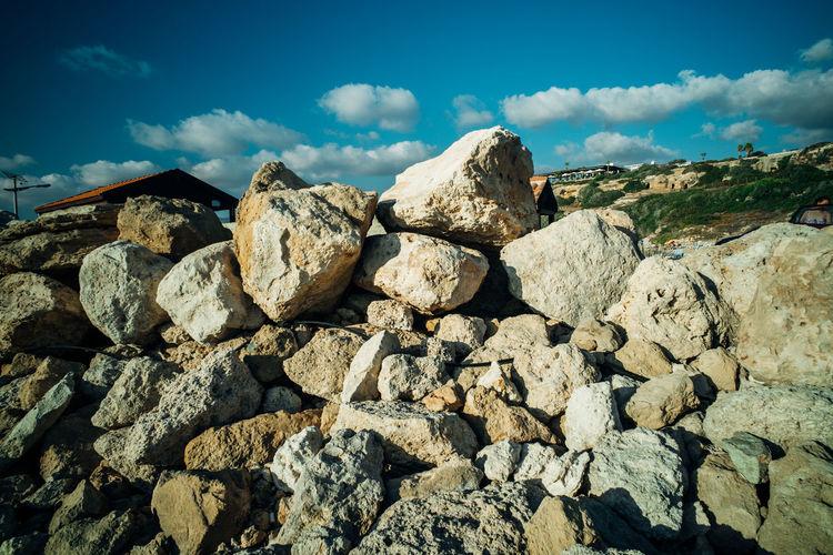 Rocks on landscape against sky