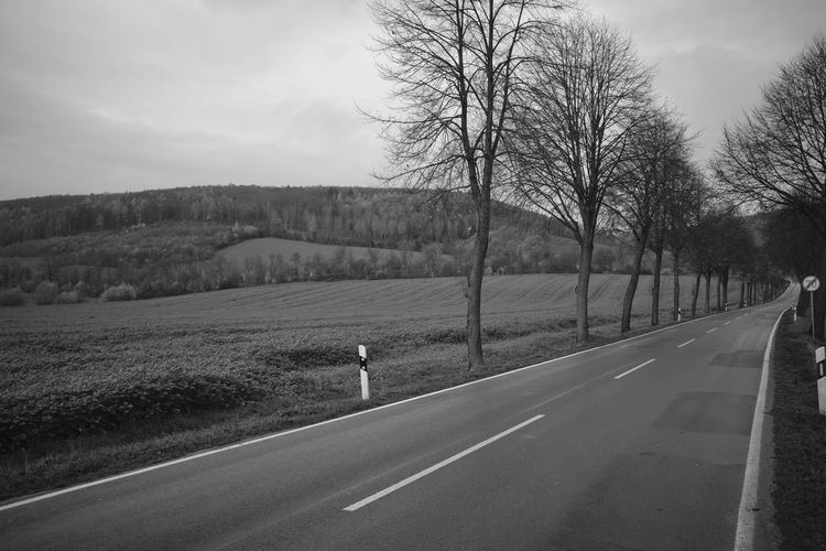 View of country road against sky