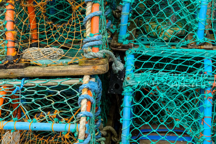 Fishing baskets on quayside at Conwy, North Wales. Conwy Close-up Day Fishing Fishing Baskets Fishing Net Harbor Lobster Baskets Lobster Pots Man Made Object Metal Nautical Vessel Netting No People North Wales Outdoors Protection Rope Safety