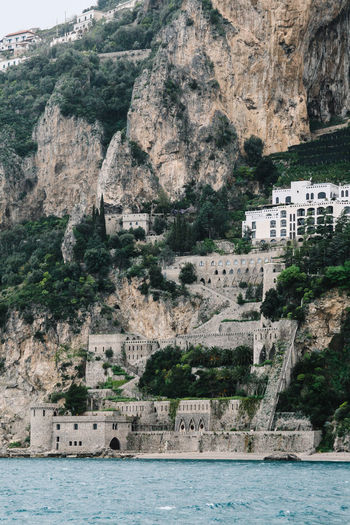Amalfi Coast, Italy Amalfi  Amalfi Coast Architecture Building Exterior Built Structure Cliff Day House Italy Mountain Nature Residential Structure River Rock Rock - Object Rock Formation Rocky Mountains Scenics Sea Town Tree Water Waterfront