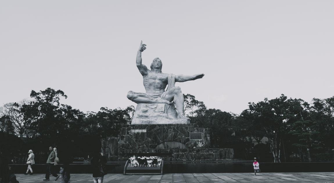 Atomic Bomb Human Representation Japan Japan Photography Low Angle View Male Likeness Nagasaki Outdoors Park - Man Made Space Peace Park Sculpture Statue