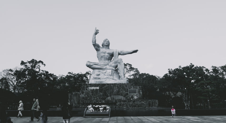 Low angle view of statue in park against clear sky