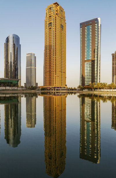 Golden sunset time in Dubai, perfect reflection at JLT area Dubai JLT Reflection UAE UAE , Dubai Architecture Beauty In Nature Building Exterior Built Structure City Dubaicity Dubaimarina Modern Nature No People Outdoors Reflection Reflection_collection Reflections In The Water Sky Skyscraper Symmetry Tall - High Urban Skyline Water