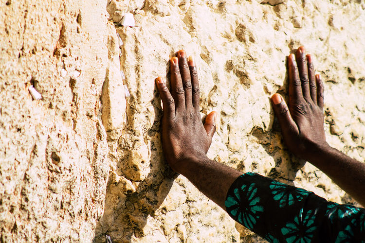 Close-up of hands on wall