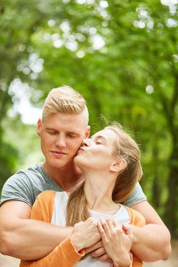 Mid Adult Couple Against Trees