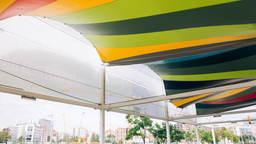 Low angle view of multi colored awnings