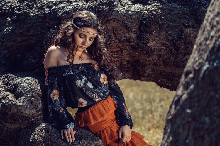Young female hippie surrounded by trees Beautiful Woman Day Hippie Lifestyles Nature One Person One Young Woman Only Outdoors People Portrait Real People Standing Tree Young Adult Young Women