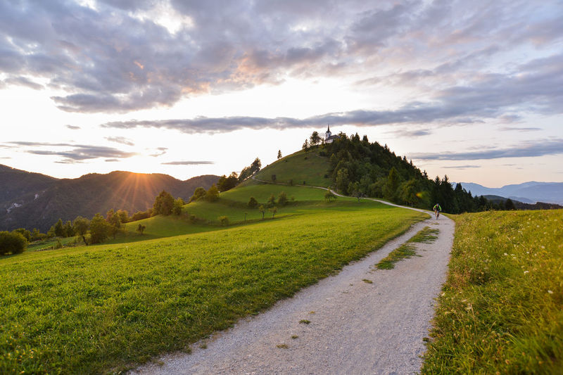 Just near my home in Ljubljana, there is a perfect hill to cool yourself in hot summer evenings. It's calle Sveti Jakob (Sanit Jacob in english) and pictures of that hill with church you have probably see in past. Very nice. Church Saint Jacob Summer Exploratorium Summertime Sunlight Sunset_collection Sveti Jakob The Great Outdoors - 2018 EyeEm Awards The Traveler - 2018 EyeEm Awards Beauty In Nature Church Architecture Cloud - Sky Environment Eveneings Grass Green Color Land Landscape Mountain Mountain Range Nature No People Non-urban Scene Outdoors Plant Religion Religious  Religious Architecture Road Scenics - Nature Sky Summer Sun Sunset Tranquil Scene Tranquility Transportation