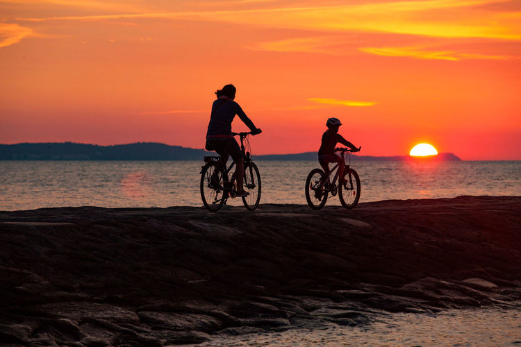 Baltic Sea Stawa Mlyny Beach Beauty In Nature Bicycle Horizon Over Water Land Land Vehicle Leisure Activity Lifestyles Nature Orange Color Outdoors Real People Riding Scenics - Nature Sea Silhouette Sky Sport Sun Sunset Tranquility Transportation Water