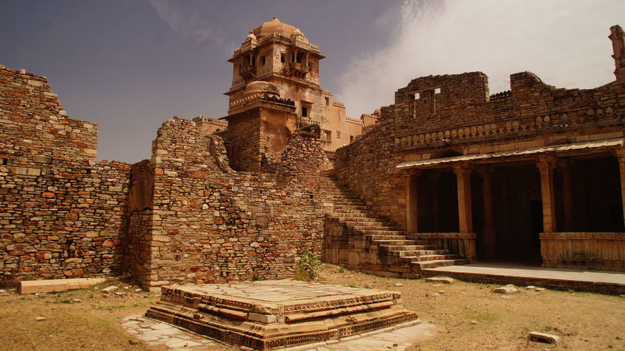 Historic abandoned building at chittorgarh district against sky