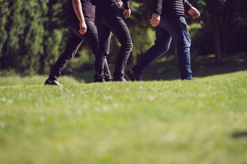 Walk in the park Low Section Human Leg Sport Body Part Grass Real People Two People Men Nature Selective Focus Togetherness Lifestyles Leisure Activity Human Body Part People Women Green Color Plant Day Adult