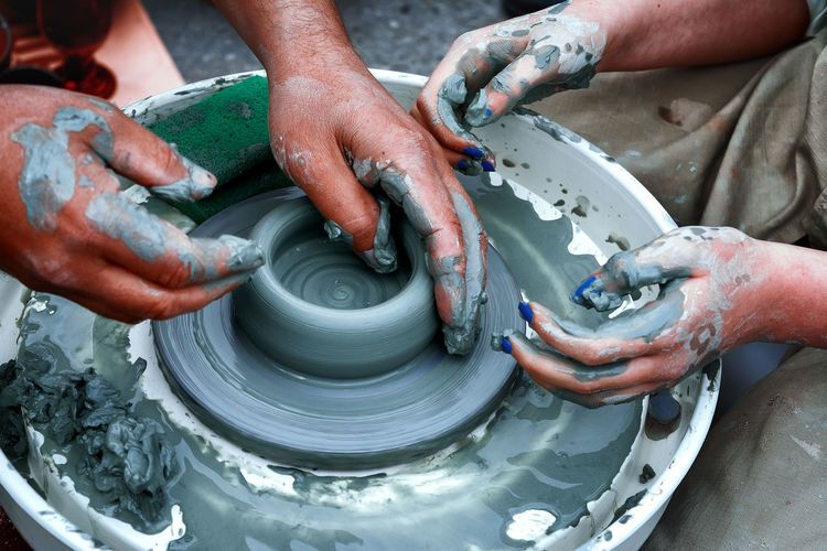 Potter's wheel Hands Working Clay Clay Work Close-up Men Modeling People Women The Week On EyeEm Modern Workplace Culture Sculptor Art Class Bust  Pot Pottery Terracotta Molding A Shape Craft Product Carving - Craft Activity Ceramics