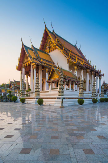 Wat Suthat Thep Wararam temple during twilight time. It is a royal temple of the first grade, one of ten such temples in Bangkok, Thailand ASIA Ancient Architecture Bangkok Buddha Buddhist Cityscape Place Of Worship Sightseeing Thailand Travel Wat Suthat Worship Attraction Building Culture Famous Place Landmark Landscape Outdoors Religion Temple Tourism Traditional Travel Destinations