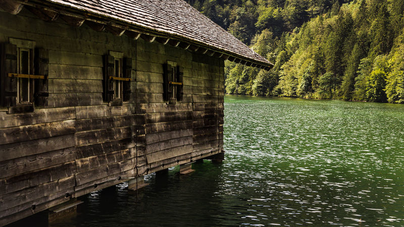 Boatshouse at the Sea Berchtesgadener Land  Königssee Landscape Photography Schönau Am Königsee Architecture Beauty In Nature Berchtesgaden Boat Building Building Exterior Built Structure Day Green Color House Lake Landscape Nature No People Outdoors Plant Reflection Tranquility Tree Water Waterfront