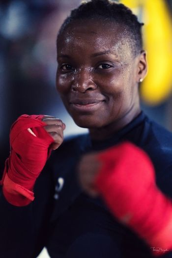 While boxing Looking At Camera One Person Lifestyles Portrait Real People Focus On Foreground Close-up Smiling People Boxing Woman girl boxing The Portraitist - 2017 EyeEm Awards