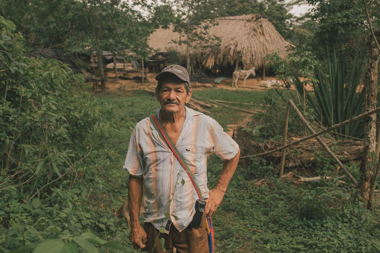 Portrait of smiling young man standing on land